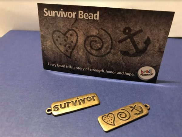 Survivor brass bead of courage